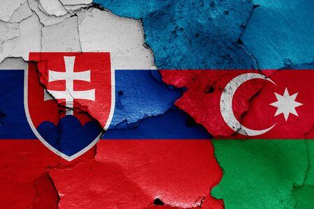 flags of Slovakia and Azerbaijan painted on cracked wall Stok Fotoğraf - 131217253