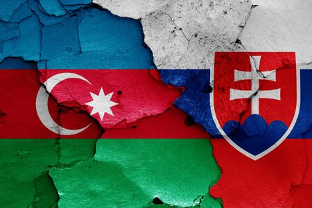 flags of Azerbaijan and Slovakia painted on cracked wall Stok Fotoğraf - 131216897