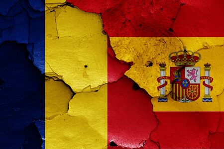 flags of Romania and Spain painted on cracked wall Stok Fotoğraf - 131217770