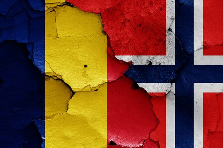 flags of Romania and Norway painted on cracked wall Stok Fotoğraf