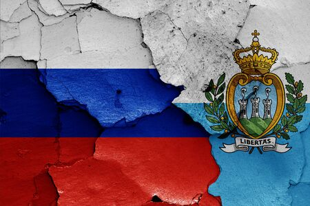 flags of Russia and San Marino painted on cracked wall