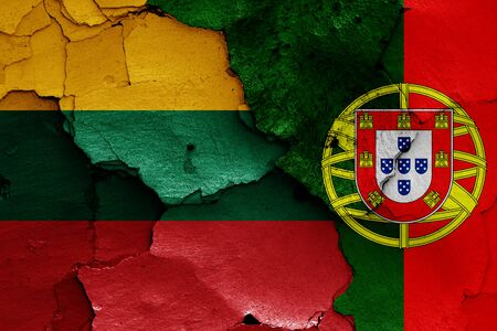 flags of Lithuania and Portugal painted on cracked wall Reklamní fotografie