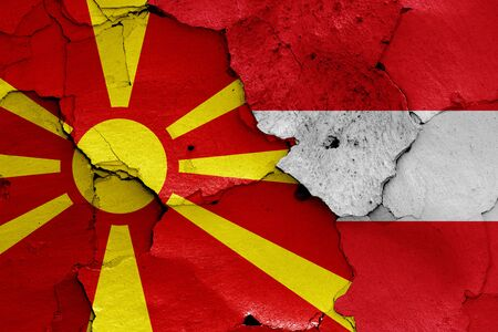 flags of North Macedonia and Austria painted on cracked wall