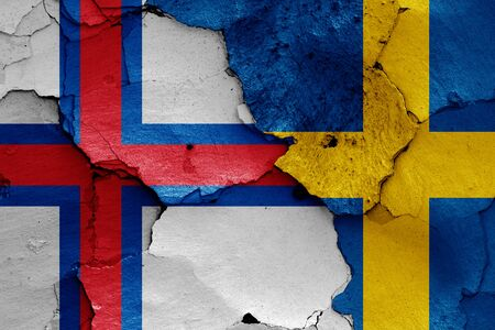 flags of Faroe Islands and Sweden painted on cracked wall