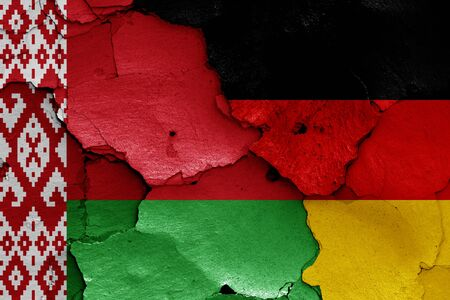 flags of Belarus and Germany painted on cracked wall Reklamní fotografie