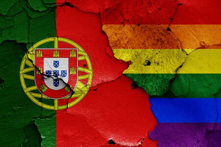 flags of Portugal and LGBT painted on cracked wall