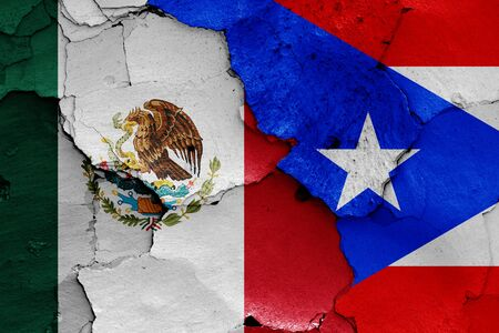 flags of Mexico and Puerto Rico painted on cracked wall