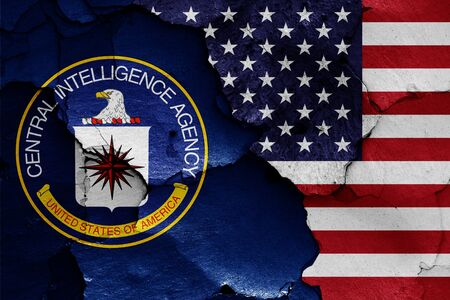 flags of Central Intelligence Agency and USA painted on cracked wall