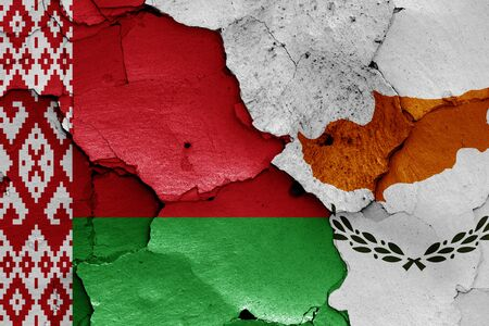 flags of Belarus and Cyprus painted on cracked wall