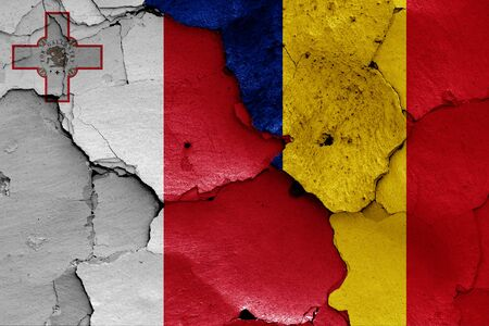 flags of Malta and Romania painted on cracked wall