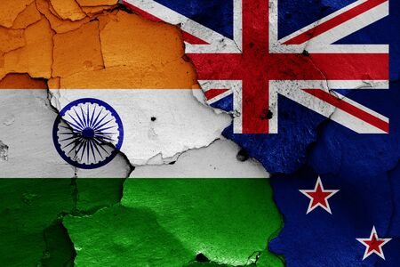 flags of India and New Zealand painted on cracked wall Zdjęcie Seryjne