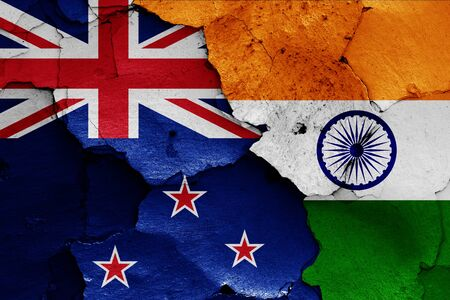flags of New Zealand and India painted on cracked wall