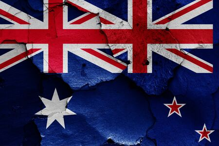 flags of Australia and New Zealand painted on cracked wall