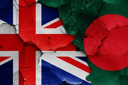 flags of UK and Bangladesh painted on cracked wall Reklamní fotografie