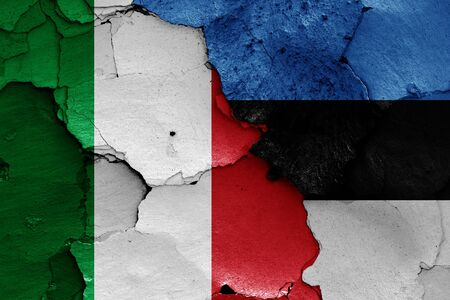 flags of Italy and Estonia painted on cracked wall Zdjęcie Seryjne