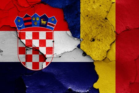 flags of Croatia and Romania painted on cracked wall Zdjęcie Seryjne