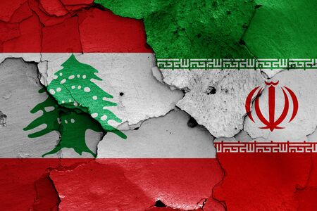 flags of Lebanon and Iran painted on cracked wall Zdjęcie Seryjne