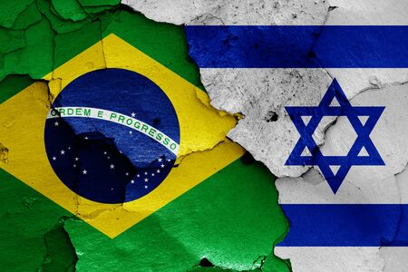 flags of Brazil and Israel painted on cracked wall