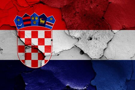flags of Croatia and Netherlands painted on cracked wall