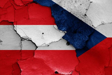 flags of Austria and Czech Republic painted on cracked wall