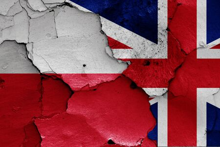 flags of Poland and UK painted on cracked wall Zdjęcie Seryjne