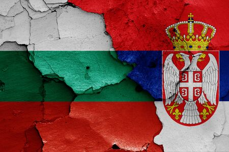 flags of Bulgaria and Serbia painted on cracked wall