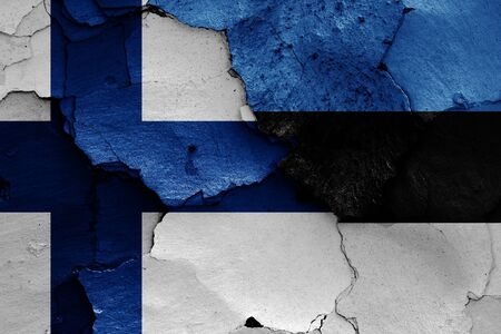flags of Finland and Estonia painted on cracked wall Zdjęcie Seryjne