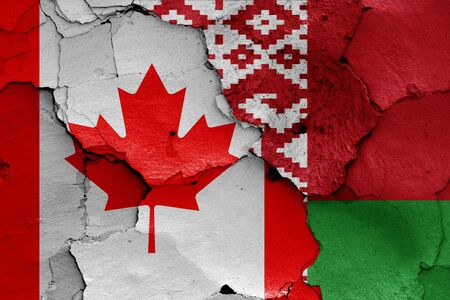 flags of Canada and Belarus painted on cracked wall