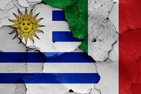 flags of Uruguay and Italy painted on cracked wall Zdjęcie Seryjne