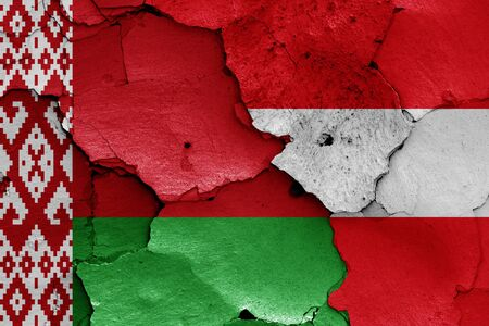 flags of Belarus and Austria painted on cracked wall