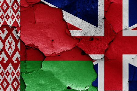 flags of Belarus and UK painted on cracked wall