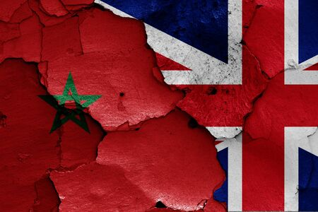 flags of Morocco and UK painted on cracked wall