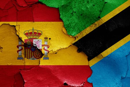 flags of Spain and Tanzania painted on cracked wall