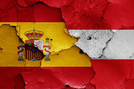 flags of Spain and Austria painted on cracked wall