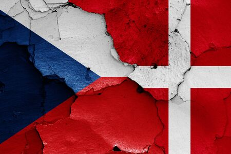 flags of Czech Republic and Denmark painted on cracked wall