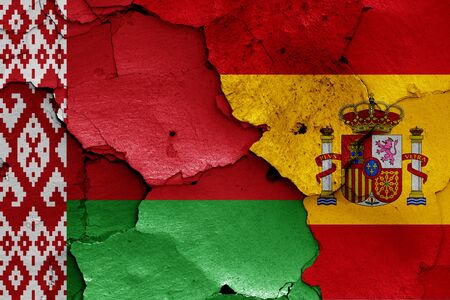 flags of Belarus and Spain painted on cracked wall