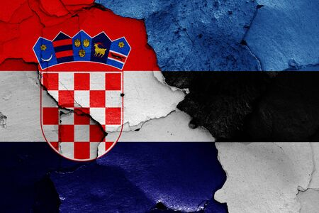 flags of Croatia and Estonia painted on cracked wall