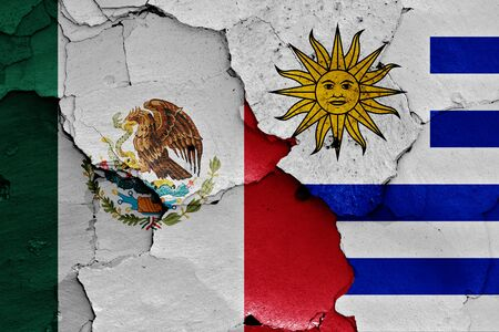 flags of Mexico and Uruguay painted on cracked wall