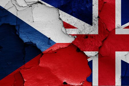 flags of Czech Republic and UK painted on cracked wall