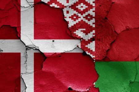flags of Denmark and Belarus painted on cracked wall Zdjęcie Seryjne