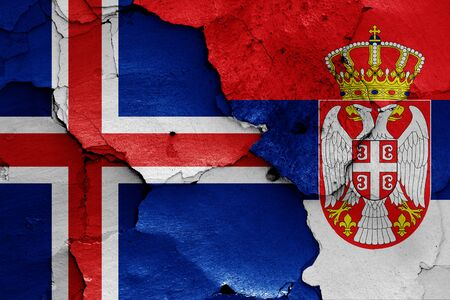 flags of Iceland and Serbia painted on cracked wall Zdjęcie Seryjne