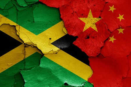 flags of Jamaica and China painted on cracked wall