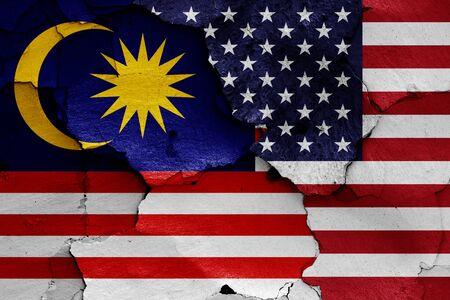 flags of Malaysia and USA painted on cracked wall Zdjęcie Seryjne