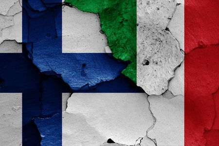 flags of Finland and Italy  painted on cracked wall