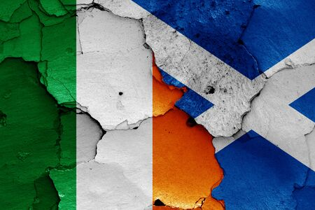 flags of Ireland and Scotland painted on cracked wall Zdjęcie Seryjne