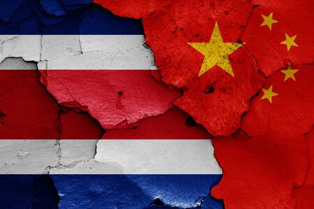 flags of Costa Rica and China painted on cracked wall Zdjęcie Seryjne