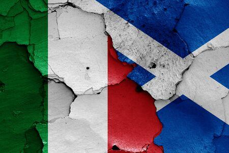 flags of Italy and Scotland painted on cracked wall