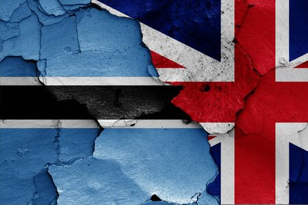 flags of Botswana and UK painted on cracked wall