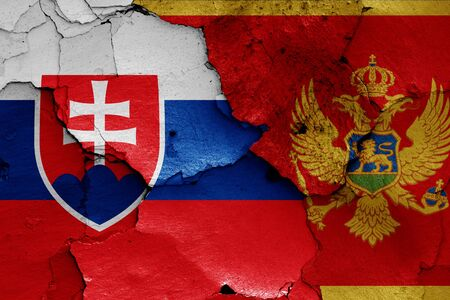 flags of Slovakia and Montenegro painted on cracked wall Zdjęcie Seryjne