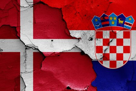 flags of Denmark and Croatia painted on cracked wall